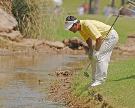 Hajime Meshiai looks for a ball in the creek  on the 18th hole  during the second round of  the 2005 Bruno's Memorial Classic, May 21, in Hoover, Al.Photo by Al Messerschmidt/WireImage.com
