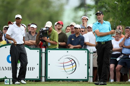 MIAMI - MARCH 22:  Geoff Ogilvy of Australia plays his tee shot at the 5th hole as Tiger Woods of the USA follows him on to the tee during the third round of the 2008 World Golf Championships CA Championship at the Doral Golf Resort & Spa, on March 22, 2008 in Miami, Florida.  (Photo by David Cannon/Getty Images)