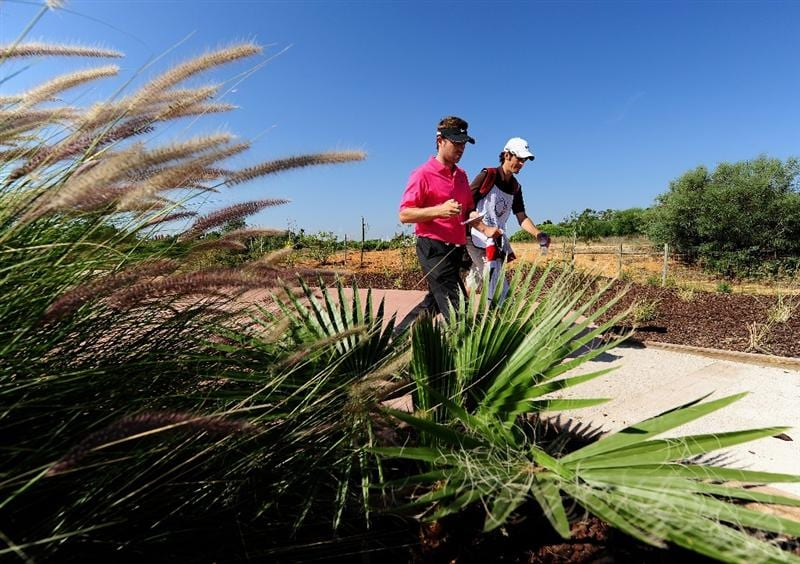 VILAMOURA, PORTUGAL - OCTOBER 17:  Pablo Martin of Spain and caddie during the third round of the Portugal Masters at the Oceanico Victoria Golf Course on October 17, 2009 in Vilamoura, Portugal.  (Photo by Stuart Franklin/Getty Images)