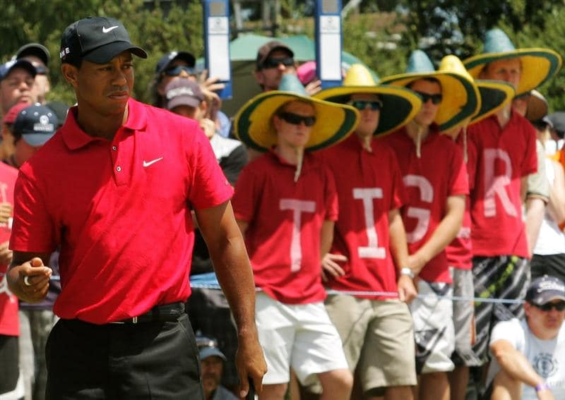 MELBOURNE, AUSTRALIA - NOVEMBER 15:  Tiger supporters watch Tiger Woods of the USA putt on the 1st hole during the final round of the 2009 Australian Masters at Kingston Heath Golf Club on November 15, 2009 in Melbourne, Australia.  (Photo by Mark Dadswell/Getty Images)