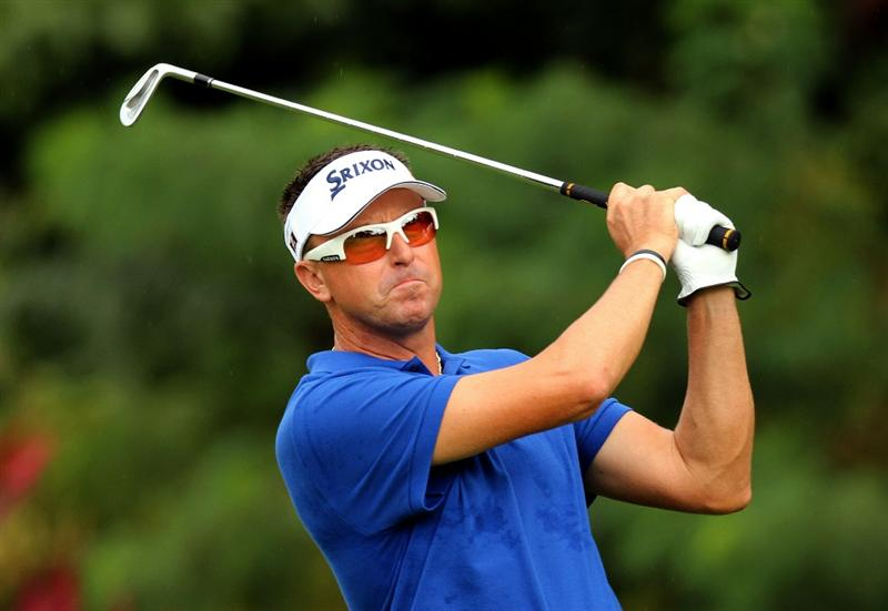 KUALA LUMPUR, MALAYSIA - OCTOBER 29: Robert Allenby of Australia watches his 2nd shot on the 1st hole during day two of the CIMB Asia Pacific Classic at The MINES Resort & Golf Club on October 29, 2010 in Kuala Lumpur, Malaysia. . (Photo by Stanley Chou/Getty Images)