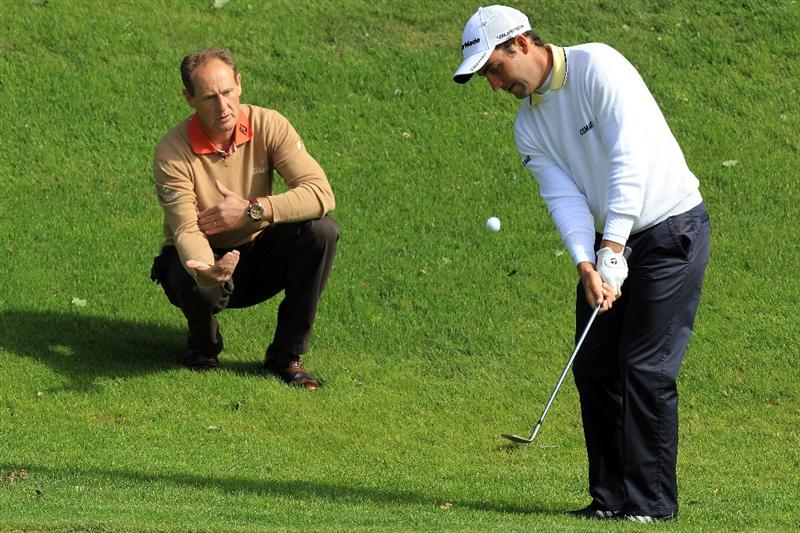 VIRGINIA WATER, ENGLAND - MAY 24:  Mark Roe of England the golf coach working with Edoardo Molinari of Italy during practice at The Wentworth Club on May 24, 2011 in Virginia Water, England.  (Photo by David Cannon/Getty Images)