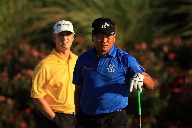 PONTE VEDRA BEACH, FL - MAY 15:  K.J. Choi of South Korea (R) and David Toms (L) look on from the 18th tee box during the final round of THE PLAYERS Championship held at THE PLAYERS Stadium course at TPC Sawgrass on May 15, 2011 in Ponte Vedra Beach, Florida.  (Photo by Streeter Lecka/Getty Images)