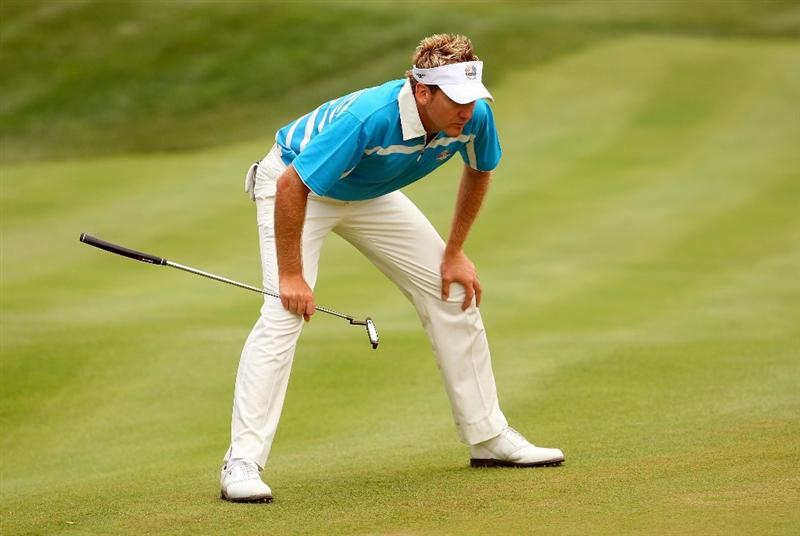 LOUISVILLE, KY - SEPTEMBER 20:  Ian Poulter of the European team lines up a putt on the 11th green during the morning foursome matches on day two of the 2008 Ryder Cup at Valhalla Golf Club on September 20, 2008 in Louisville, Kentucky.  (Photo by Andrew Redington/Getty Images)