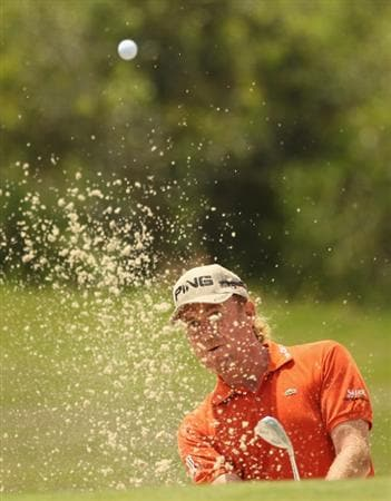 CASARES, SPAIN - MAY 19:  Miguel Angel Jimenez of Spain plays out of the second greenside bunker during the group stages of the Volvo World Match Play Championships at Finca Cortesin on May 19, 2011 in Casares, Spain.  (Photo by Warren Little/Getty Images)