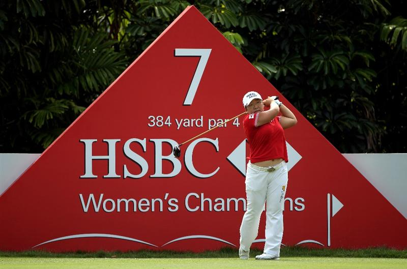 SINGAPORE - FEBRUARY 28:  Jiyai Shin of South Korea hits her tee-shot on the seventh hole during the final round of the HSBC Women's Champions at the Tanah Merah Country Club on February 28, 2010 in Singapore.  (Photo by Andrew Redington/Getty Images)