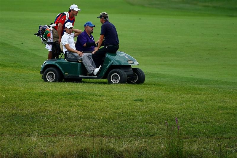 OAKVILLE, ONTARIO - JULY 24:  Camilo Villegas of Columbia and Daniel Chopra of Sweden (R) are taken back to the clubhouse after play was suspended due to lightning strikes during round two of the RBC Canadian Open at Glen Abbey Golf Club on July 24, 2009 in Oakville, Ontario, Canada.  (Photo by Chris McGrath/Getty Images)