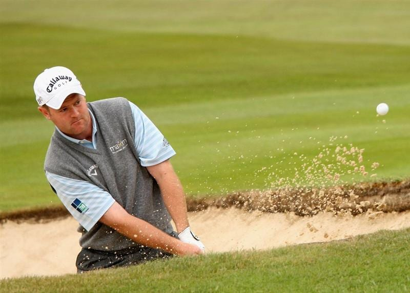 SUNNINGDALE, ENGLAND - JUNE 08:  Alastair Forsyth of Scotland plays a bunker shot on the 18th hole on his way to shooting 66 on the Old Course during the morning's play at The Open Championship International Final Qualifying on June 8, 2009 at Sunningdale Golf Club in Sunningdale, England.  (Photo by Andrew Redington/Getty Images)