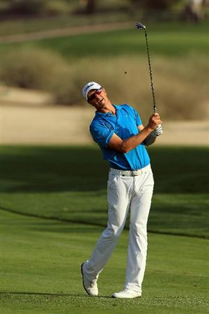 DUBAI, UNITED ARAB EMIRATES - FEBRUARY 10:  Fredrik Andersson Hed of Sweden plays his second shot to the 16th hole during the first round of the 2011 Omega Dubai Desert Classic on the Majilis Course at the Emirates Golf Club on February 10, 2011 in Dubai, United Arab Emirates.  (Photo by David Cannon/Getty Images)