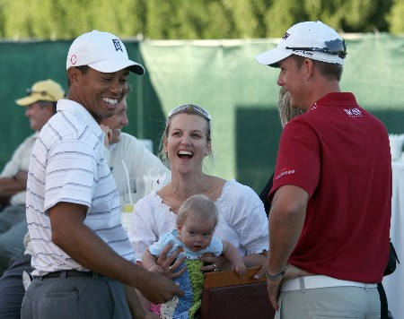 DUBAI, UNITED ARAB EMIRATES - JANUARY 29:  Tiger Woods of the USA enjoys a lighthearted moment with Henrik Stenson of Sweden and his wife Emma with the Stenson's baby daughter after the Dubai Desert Classic Challenge Match, held on the par 3, course at the Emirates Golf Club, on January 29, 2007 in Dubai, United Arab Emirates.  (Photo by David Cannon/Getty Images)