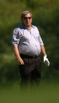 Fuzzy Zoeller checks his lie on the 6th hole during the first round of the Champions' Tour 2005 SBC Classic at the Valencia Country Club in Valencia, California March 11, 2005.