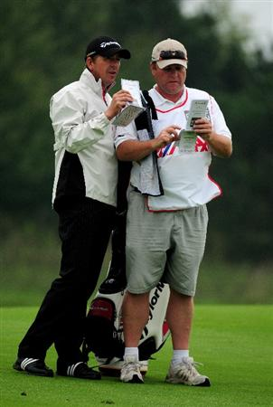 VIENNA, AUSTRIA - SEPTEMBER 17:  Scott Drummond of Scotland looks at his yardage book with his caddy during the first round of the Austrian Golf Open at Fontana Golf Club on September 17, 2009 in Vienna, Austria.  (Photo by Richard Heathcote/Getty Images)