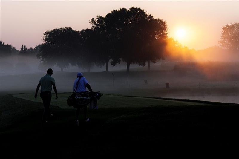 CHASKA, MN - AUGUST 11:  (L-R) Martin Kaymer of Germany walks with caddie Justin Grenfell-Hoyle walk together during the second preview day of the 91st PGA Championship at Hazeltine National Golf Club on August 11, 2009 in Chaska, Minnesota.  (Photo by Sam Greenwood/Getty Images)