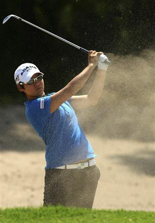MELBOURNE, AUSTRALIA - FEBRUARY 03:  Yani Tseng of Taiwan plays a shot out of the bunker during day one of the Women's Australian Open at The Commonwealth Golf Club on February 3, 2011 in Melbourne, Australia.  (Photo by Lucas Dawson/Getty Images)