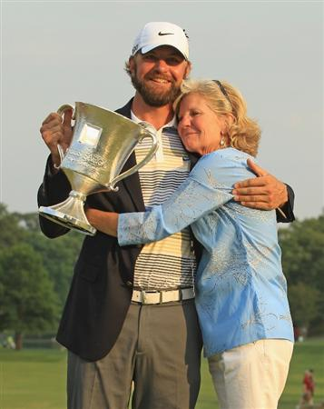 CHARLOTTE, NC - MAY 08:  Lucas Glover poses with the trophy and his mother Hershey after defeating Jonathan Byrd on the first playoff hole during the final round of the Wells Fargo Championship at the Quail Hollow Club on May 8, 2011 in Charlotte, North Carolina.  (Photo by Streeter Lecka/Getty Images)