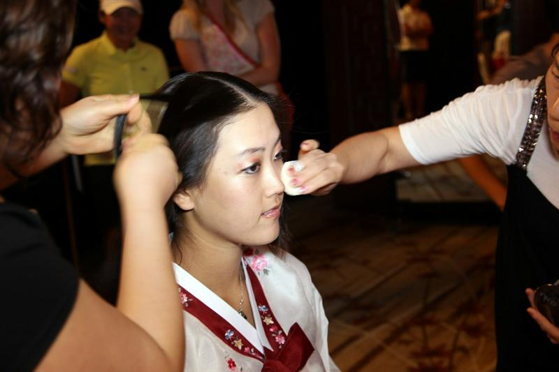SINGAPORE - FEBRUARY 22:  Michelle Wie of the USA is dressed in traditional Korean dress during a photocall at the Fairmont Hotel prior to the HSBC Women's Champions at Tanah Merah Country Club  on February 22, 2011 in Singapore, Singapore.  (Photo by Ross Kinnaird/Getty Images)