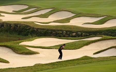 SHENZHEN, CHINA - NOVEMBER 23:  Anders Hansen of Denmark plays from a bunker on the 15th during the second round of the Omega Mission Hills World Cup at the Mission Hills Resort on 23 November 2007 in Shenzhen, China.  (Photo by Richard Heathcote/Getty Images)