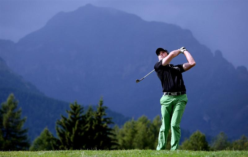 CRANS, SWITZERLAND - SEPTEMBER 03:  Oliver Wilson of England plays his second shot on the 12th hole during the first round of The Omega European Masters at Crans-Sur-Sierre Golf Club on September 3, 2009 in Crans Montana, Switzerland.  (Photo by Andrew Redington/Getty Images)