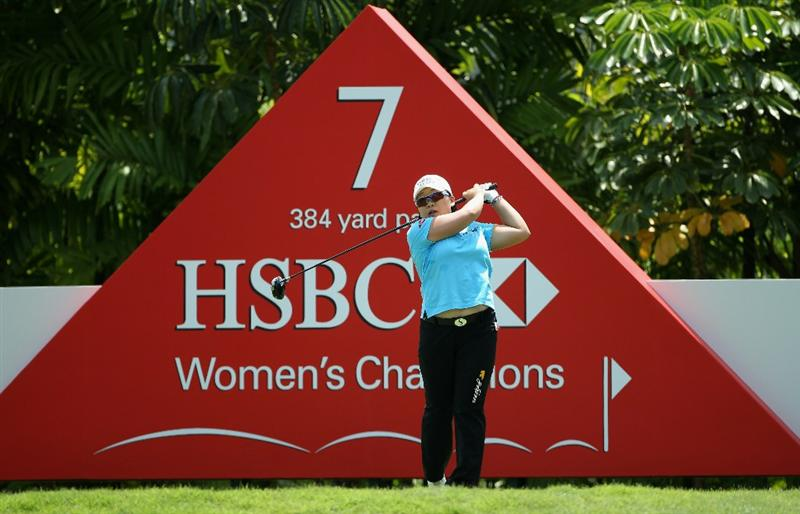 SINGAPORE - FEBRUARY 24:  Jiyai Shin of South Korea hits her tee-shot on the seventh hole during the first round of the HSBC Women's Champions at the Tanah Merah Country Club on February 24, 2011 in Singapore.  (Photo by Andrew Redington/Getty Images)