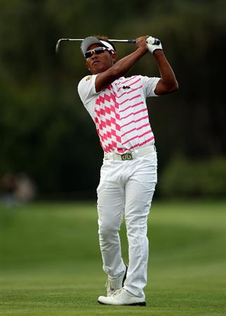 DUBAI, UNITED ARAB EMIRATES - FEBRUARY 07:  Thongchai Jaidee of Thailand in action during the final round of the Omega Dubai Desert Classic on February 7, 2010 in Dubai, United Arab Emirates.  (Photo by Andrew Redington/Getty Images)