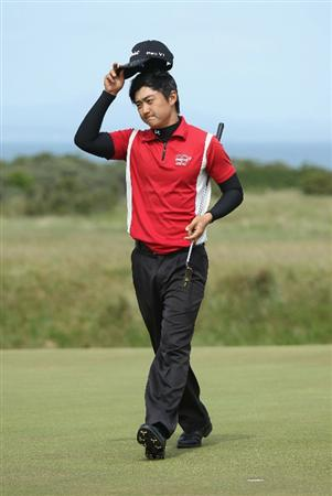 GULLANE, SCOTLAND - JUNE 18:  Jin Jeong of Korea acknowledges the crowd after winning his Quarter Final match against Paul Cutler of Northern Ireland during The Amateur Championship at Muirfield Golf Club on June 18, 2010 in Gullane, Scotland.  (Photo by Warren Little/Getty Images)