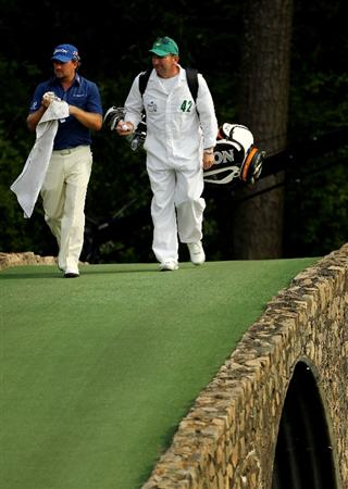 AUGUSTA, GA - APRIL 08:  Graeme McDowell of Northern Ireland walks back across the Hogan Bridge with his caddie Ken Comboy aftre losing a ball on the 12th hole during the second round of the 2011 Masters Tournament at Augusta National Golf Club on April 8, 2011 in Augusta, Georgia.  (Photo by Jamie Squire/Getty Images)