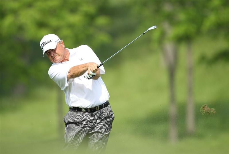 LOUISVILLE, KY - MAY 29:  David Eger hits his second shot on the par 4 17th hole during the Senior PGA Championship presented by KitchenAid at Valhalla Golf Club on May 29, 2011 in Louisville, Kentucky.  He lost in a one hole playoff to Tom Watson .  (Photo by Andy Lyons/Getty Images)