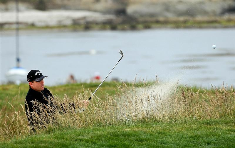 PEBBLE BEACH, CA - JUNE 18:  Shaun Micheel  plays his bunker shot on the 17th hole during the second round of the 110th U.S. Open at Pebble Beach Golf Links on June 18, 2010 in Pebble Beach, California.  (Photo by Jeff Gross/Getty Images)