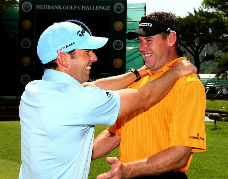 SUN CITY, SOUTH AFRICA - DECEMBER 03:  Sergio Garcia of Spain and Lee Westwood of England embrace during the pro-am for the Nedbank Golf Challenge at the Gary Player Country Club on December 3, 2008 in Sun City, South Africa.  (Photo by Richard Heathcote/Getty Images)