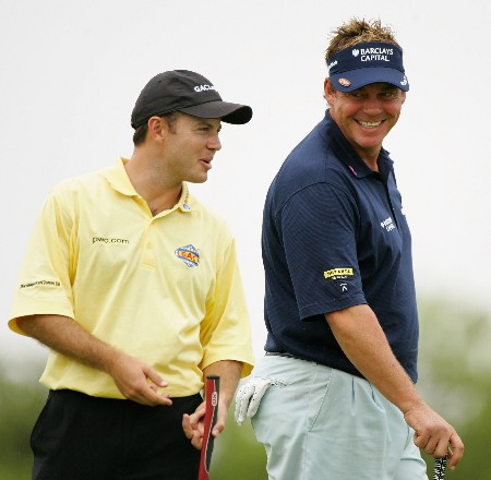 MALELANE, SOUTH AFRICA - DECEMBER 07:  Darren Clarke of Northern Ireland jokes with Richard Sterne of South Africa during the second round of The Alfred Dunhill Championship at The Leopard Creek Country Club on December 7, 2007 in Malelane, South Africa.  (Photo by Warren Little/Getty Images)