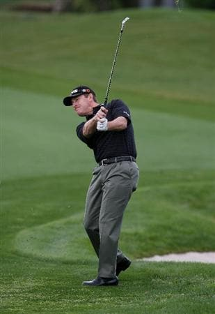 PALM BEACH GARDENS, FL - MARCH 05:  Jeff Maggert hits his approach shot on the 18th hole during the first round of The Honda Classic at PGA National Resort and Spa on March 5, 2009 in Palm Beach Gardens, Florida.  (Photo by Doug Benc/Getty Images)