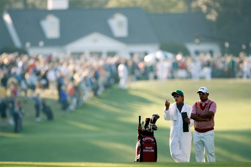 AUGUSTA, GA - APRIL 09:  Prayad Marksaeng of Thailand looks at his second shot on the first hole with his caddie Ekalak Phimphiset during the first round of the 2009 Masters Tournament at Augusta National Golf Club on April 9, 2009 in Augusta, Georgia.  (Photo by Jamie Squire/Getty Images)