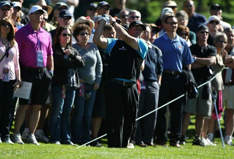 PEBBLE BEACH, CA - FEBRUARY 11:  Phil Mickelson hits on the first hole at the AT&T Pebble Beach National Pro-Am- Round Two at the Spyglass golf club on February 11, 2011 in Pebble Beach, California.  (Photo by Jed Jacobsohn/Getty Images)