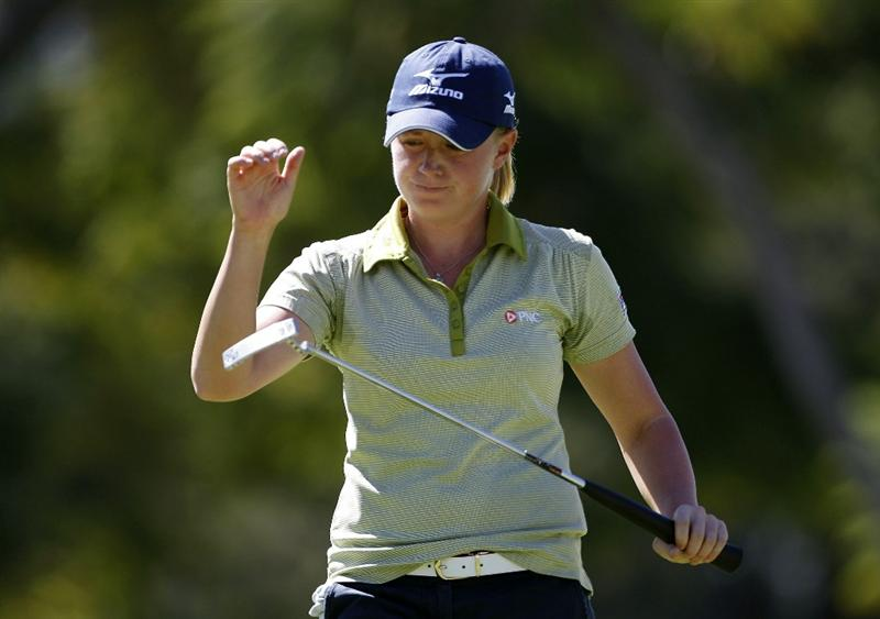 GUADALAJARA, MEXICO - NOVEMBER 13: Stacy Lewis of the United States reacts to her missed birdie putt on the second green during the third round of the Lorena Ochoa Invitational Presented by Banamex and Corona Light at Guadalajara Country Club on November 13, 2010 in Guadalajara, Mexico.  (Photo by Michael Cohen/Getty Images)