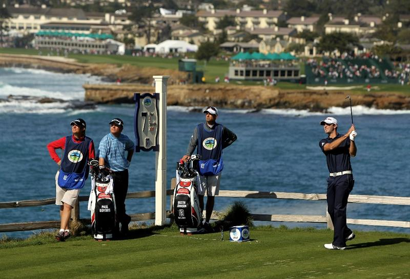 PEBBLE BEACH, CA - FEBRUARY 14:  Dustin Johnson tees off on the seventh hole during the final round of the AT&T Pebble Beach National Pro-Am at Pebble Beach Golf Links on February 14, 2010 in Pebble Beach, California.  (Photo by Ezra Shaw/Getty Images)