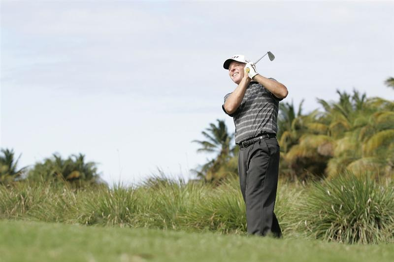 RIO GRANDE, PR - MARCH 13: Michael Bradley hits his second shot on the 17th hole from the rough during the final round of the Puerto Rico Open presented by seepuertorico.com at Trump International Golf Club on March 13, 2011 in Rio Grande, Puerto Rico.  (Photo by Michael Cohen/Getty Images)
