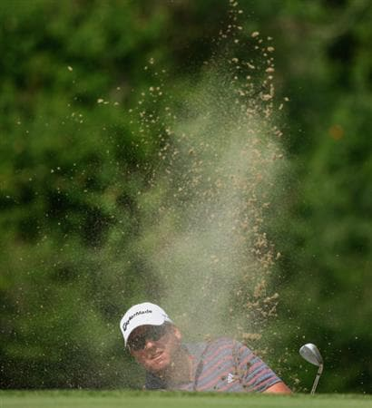 NELSPRUIT, SOUTH AFRICA - DECEMBER 13:  Michael Jonzon of Sweden plays out of the 16th greenside bunker during the third round of the Alfred Dunhill Championship at Leopard Creek Country Club on December 13, 2008 in Malelane, South Africa.  (Photo by Warren Little/Getty Images)