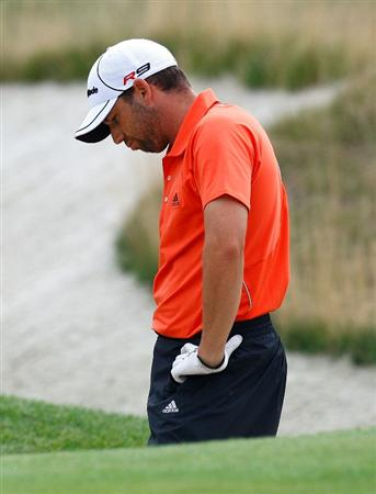 JERSEY CITY, NJ - AUGUST 29:  Sergio Garcia of Spain reacts after hitting out of the sand trap on the 12th hole during round three of The Barclays on August 29, 2009 at Liberty National in Jersey City, New Jersey.  (Photo by Kevin C. Cox/Getty Images)