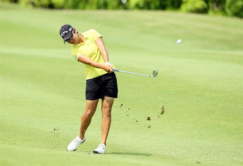 SINGAPORE - FEBRUARY 27: Yani Tseng of Taiwan hits her second shot on the 5th hole during the third round of the HSBC Women's Champions at Tanah Merah Country Club on February 27, 2010 in Singapore, Singapore.  (Photo by Andy Lyons/Getty Images)