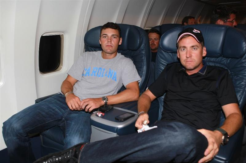 JACKSONVILLE, FL - MAY 15:  European Tour players Martin Kaymer of Germany (L), Graeme McDowell of Northern Ireland (C) and Ian Poulter of England (R) are seen onboard a plane departing from the Jacksonville Airport for Spain and the Volvo World Match Play Championship on May 15, 2011 in Jacksonville, Florida.  (Photo by Scott Halleran/Getty Images for IMG)