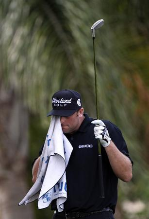 ORLANDO, FL - MARCH 27:  Steve Marino wipes his face with a towel on the 13th hole during the final round of the Arnold Palmer Invitational presented by MasterCard at the Bay Hill Club and Lodge on March 27, 2011 in Orlando, Florida.  (Photo by Sam Greenwood/Getty Images)