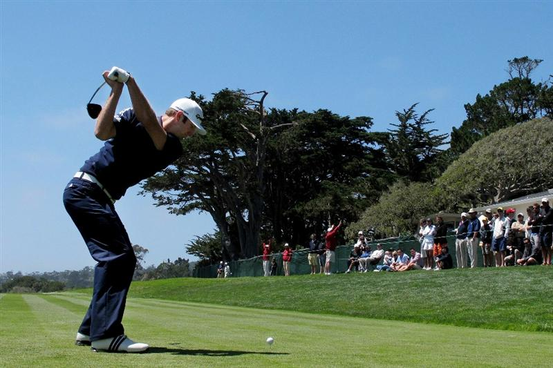 PEBBLE BEACH, CA - JUNE 17:  Dustin Johnson hits his tee shot on the 14th hole during the first round of the 110th U.S. Open at Pebble Beach Golf Links on June 17, 2010 in Pebble Beach, California.  (Photo by Andrew Redington/Getty Images)