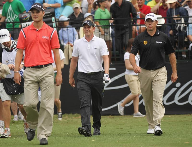 DORAL, FL - MARCH 10:  (L-R) Martin Kaymer of Germany, Luke Donald and Lee Westwood of England walk off the the first tee during the first round of the 2011 WGC- Cadillac Championship at the TPC Blue Monster at the Doral Golf Resort and Spa on March 10, 2011 in Doral, Florida.  (Photo by Mike Ehrmann/Getty Images)