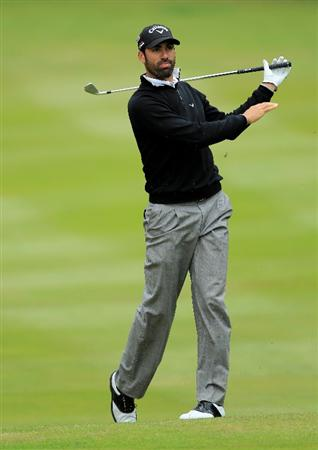 VIRGINIA WATER, ENGLAND - MAY 28:  Alvaro Quiros of Spain reacts to his 2nd shot on the 12th hole during the third round of the BMW PGA Championship at the Wentworth Club on May 28, 2011 in Virginia Water, England.  (Photo by David Cannon/Getty Images)