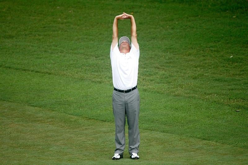 GREENSBORO, NC - AUGUST 20:  Fred Couples stretches after a rain delay on the 9th hole during the first round of the Wyndham Championship at Sedgefield Country Club on August 20, 2009 in Greensboro, North Carolina  (Photo by Streeter Lecka/Getty Images)