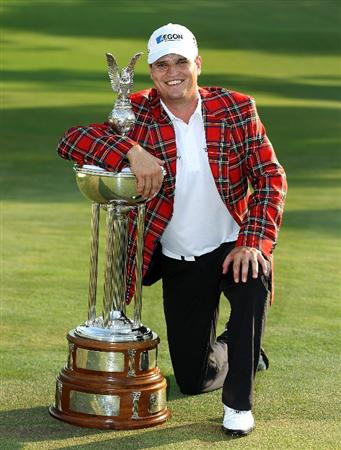 FT. WORTH, TX - MAY 30:  Zach Johnson poses with the trophy after his three-stroke victory at the 2010 Crowne Plaza Invitational at the Colonial Country Club on May 30, 2010 in Ft. Worth, Texas.  (Photo by Scott Halleran/Getty Images)