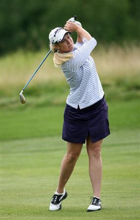 CALGARY, AB - SEPTEMBER 03: Brittany Lincicome of the United States hits her second shot on the 18th hole during the first round of the Canadian Women's Open at Priddis Greens Golf & Country Club on September 3, 2009 in Calgary, Alberta, Canada. (Photo by Hunter Martin/Getty Images)