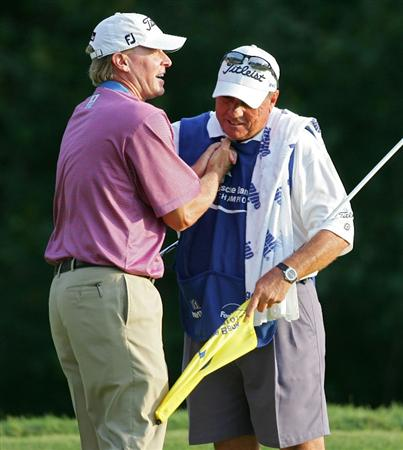 NORTON, MA - SEPTEMBER 07:  Steve Stricker celebrates with his caddie Jimmy Johnson after his winning putt on the 18th green during the final round of the Deutsche Bank Championship at TPC Boston held on September 7, 2009 in Norton, Massachusetts.  (Photo by Michael Cohen/Getty Images)