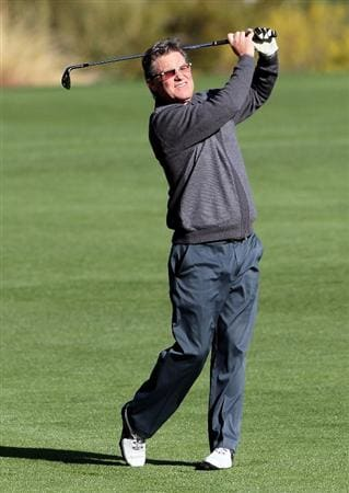 LA QUINTA, CA - JANUARY 20:  Kurt Russell hits his approach shot on the 12th hole during the first round of the Bob Hope Classic at the Silver Rock Resort on January 20, 2010 in La Quinta, California.  (Photo by Jeff Gross/Getty Images)