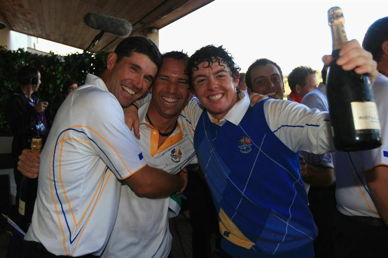 NEWPORT, WALES - OCTOBER 04:  (L-R) Padraig Harrington, Sergio Garcia and Rory McIlroy of Europe celebrate on the balcony of the clubhouse following Europe's victory in the 2010 Ryder Cup at the Celtic Manor Resort on October 4, 2010 in Newport, Wales.  (Photo by David Cannon/Getty Images)